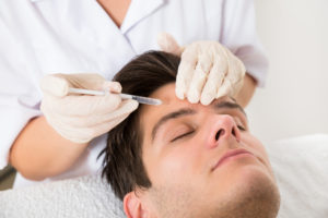 44702571 - young man having botox treatment at beauty clinic